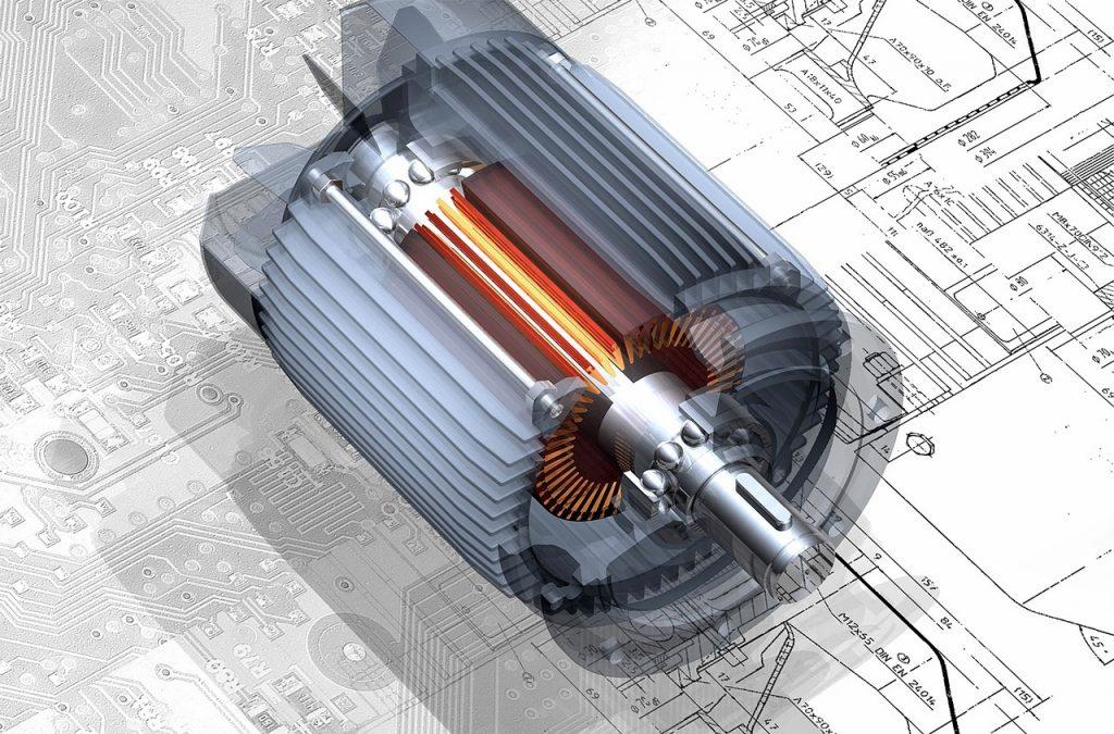 Un componente meccanico sopra alcuni disegni tecnici.
